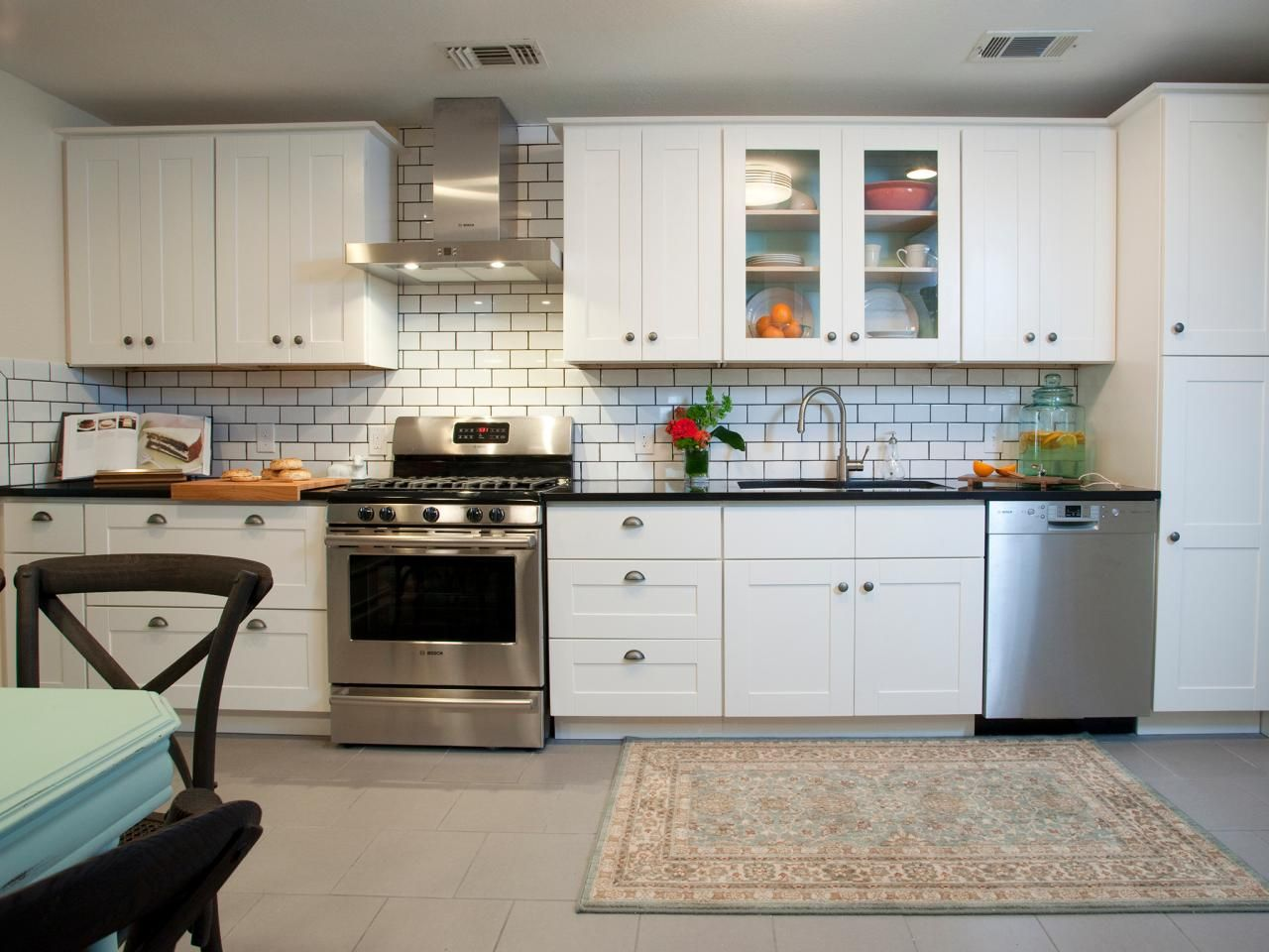 contemporary white kitchen with subway tiles